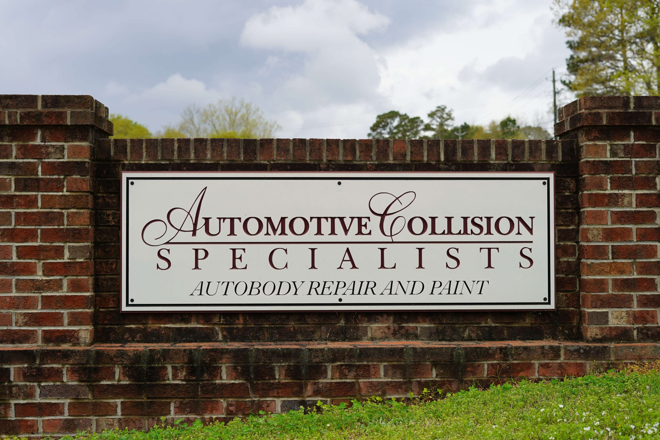 Photo of the sign in front of the Automotive Collision Specialists Auto Body Repair and Paint shop in Fuquay Varina North Carolina NC