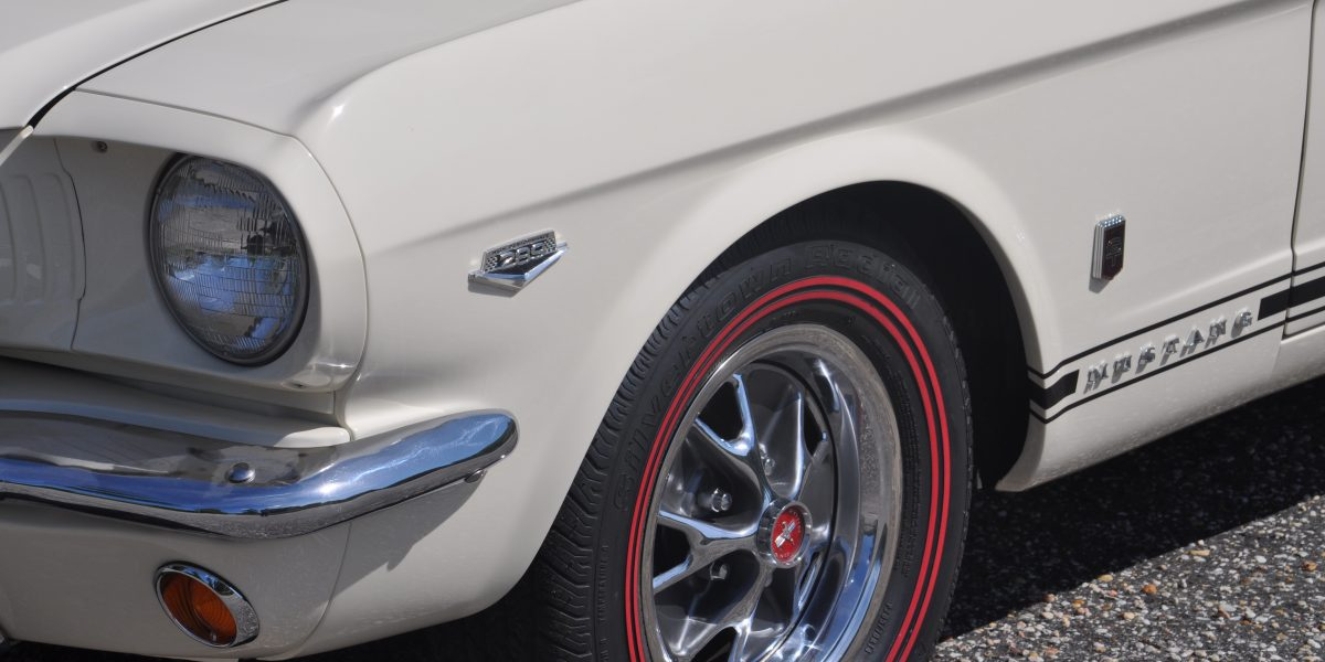 Close up photo of the front left corner of a rare classic mustang convertible collector car from Ontario Canada restored by Automotive Collision Specialists in Fuquay Varina NC