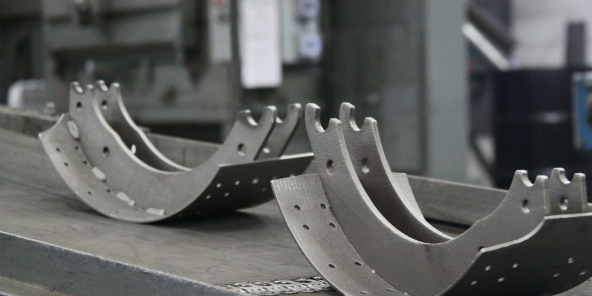 Stock photo of brake shoe linings during the remanufacturing process.