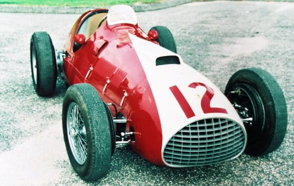 Front view of a classic red and white 1951 Ferrari F1 open wheel race car (one of two) after paint and body restoration at Automotive Collision Specialists in Fuquay Varina NC