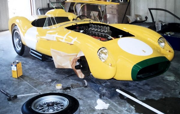 Photo of a classic yellow 1957 Ferrari Testarossa in the Automotive Collision Specialists shop in Fuquay Varina NC for paint repair after collision.