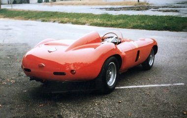 Rear three-quarter photo of a red 1954 Ferrari Monza Spider at Automotive Collision Specialists in Fuquay Varina NC after auto body and paint restoration.