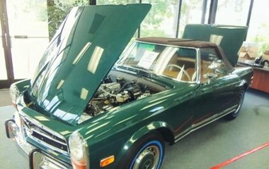 Front three quarter view photo of a green 1970 Mercedes Benz 280 SL at Automotive Collision Specialists in Fuquay Varina NC after a concourse level restoration.