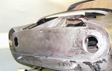 Photo of a silver Ferrari Lusso GT Berlinetta during show quality auto body and paint restoration at the Automotive Collision Specialists auto body shop in Fuquay Varina NC.