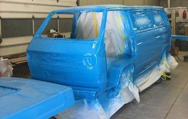 Photo of a blue Volkswagen Vanagon after auto body repair and custom paint by Automotive Collision Specialists in Fuquay Varina NC.