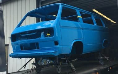 Photo of a blue Volkswagen Vanagon at the rolling body stage after auto body repair and custom paint by Automotive Collision Specialists in Fuquay Varina NC.